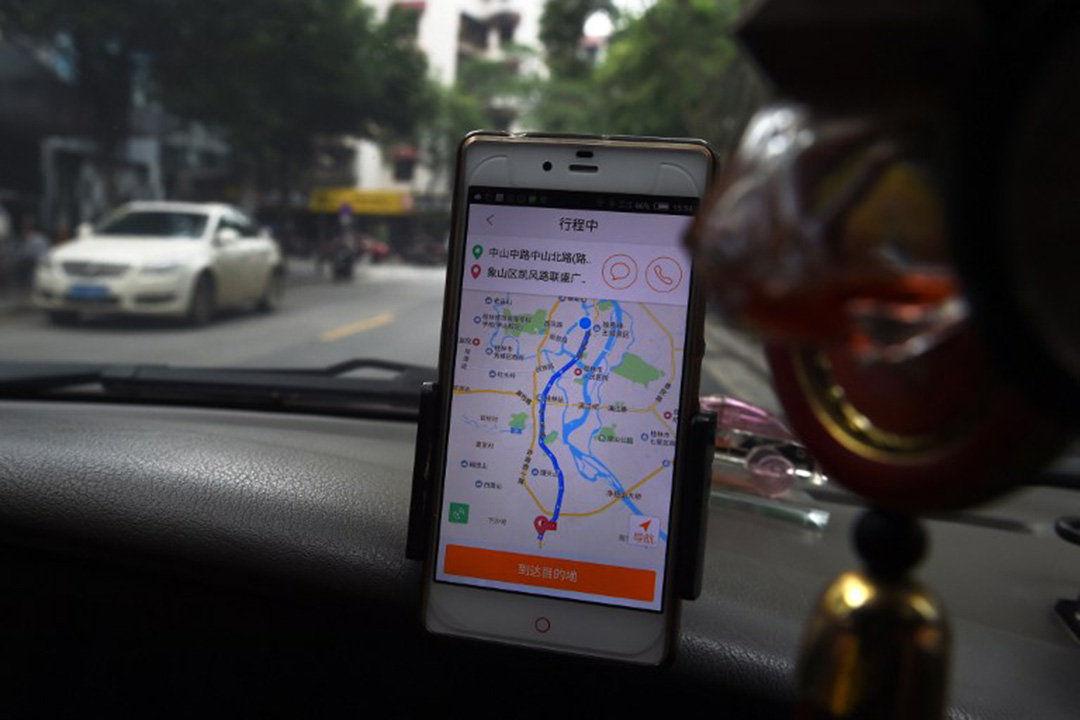 CHINA-US-APPLE-DIDI-RIDESHARING-UBER